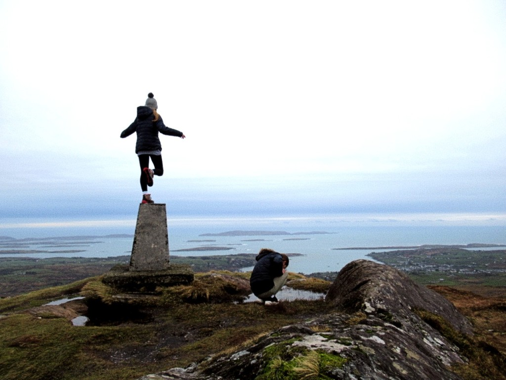 child balancing on trig beacon at mount gabriel