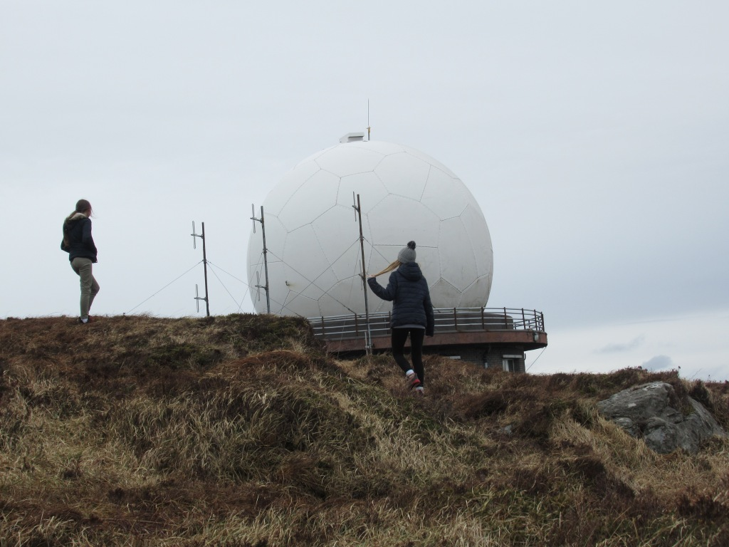 Children looking at the radar dome on mount gabriel near schull